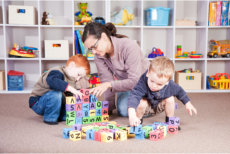 teacher and students playing blocks
